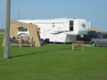 an RV in the campsite at Galveston Island State Park